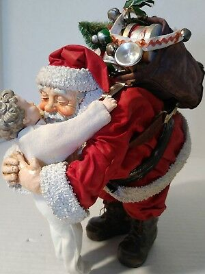 Possible Dreams Clothtique Hugging Santa 1991 figure. Nice !