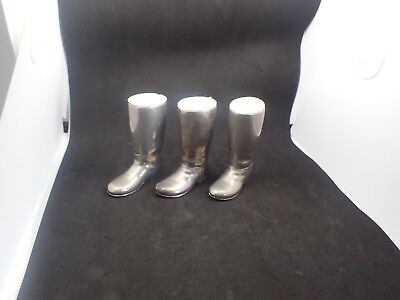 A collection of 3 Silver Plated miniature spirit measure Boots