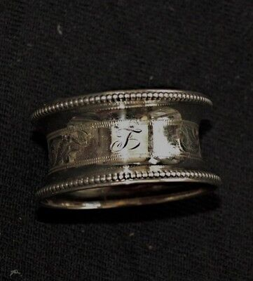 Solid Birmingha silver napkin ring  marked G E W &S   F 1905. G F Westwood & Son