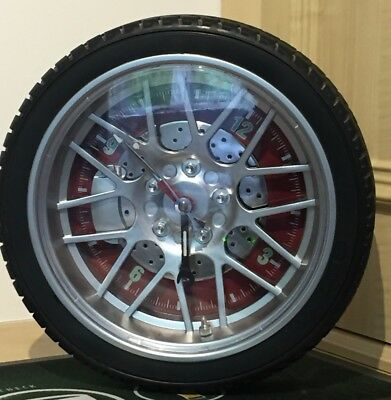 Novelty tyre car wheel wall clock, Red face with glow in the dark arms.