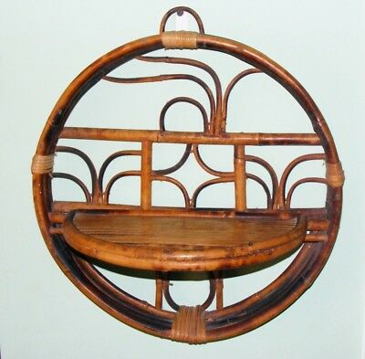 Vintage 1970's round rattan bamboo wall shelf . Retro look, great condition.