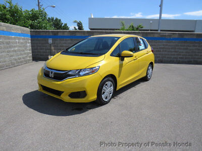Honda Fit LX CVT LX CVT New 4 dr Sedan CVT Gasoline 1.5L 4 Cyl Helios Yellow Pearl