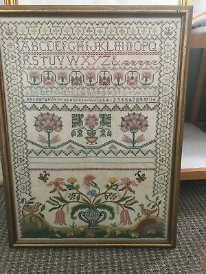 vintage embroidered sampler cotton and wool yarns on linen