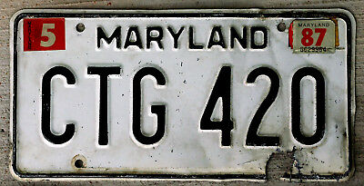 Black on White Maryland License Plate with a 1987 Sticker