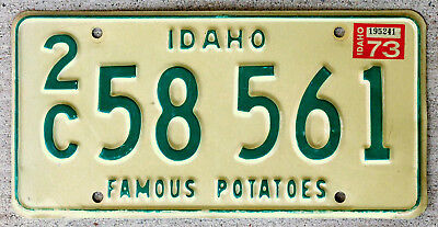 """Green on White Idaho License Plate """"2C"""" with a 1973 Sticker"""
