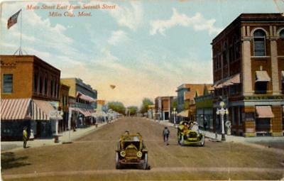 Miles City, Montana - Driving down Main Street from Seventh St. - c1910