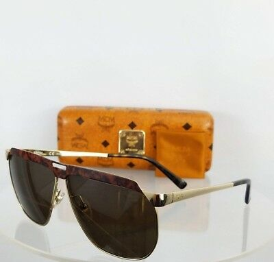 fd346381e9a Brand New Authentic MCM Sunglasses MCM 113 726 61mm Brown Silver Frame