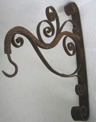 Vintage Wrought Iron Wall Bracket With Hook  .