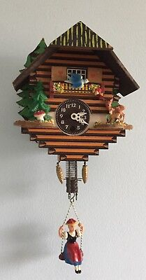 Vintage Cuckoo style Clock German Girl on a Swing Wind up working WITH  Key