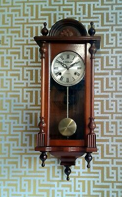 Antique style clockwork wall clock. Hour and half hour chimes. Full guarantee.