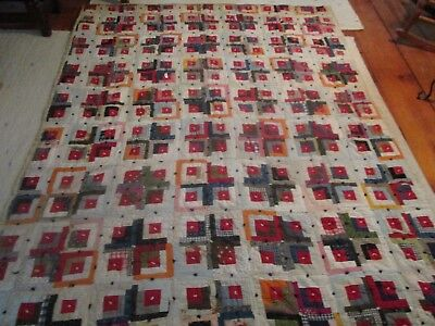 Antique log cabin quilt, red's blue and heavy.