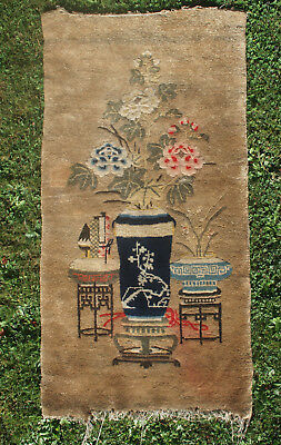 A beautiful handwoven Chinese carpet depicting a vase of peony flowers