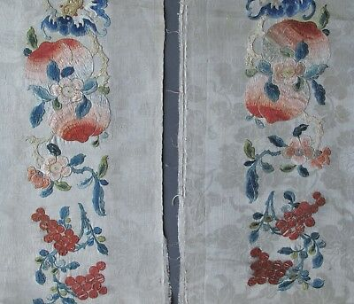 A pair of wide late C19th Chinese cream silk sleeve bands with bats and peaches