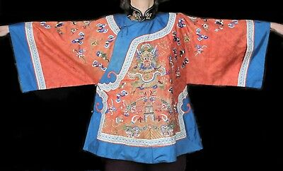 A Chinese red silk jacket with dragon decoration, late Qing