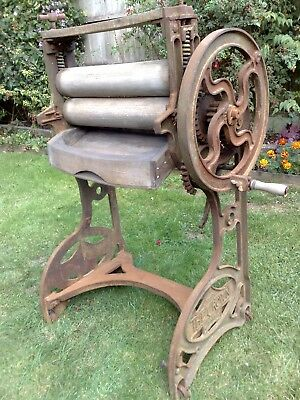 large vintage cast iron clothes mangle garden ornament  joy maid crown working