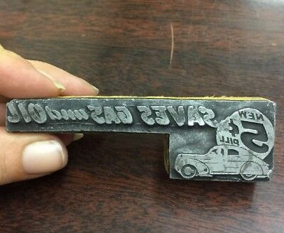 "Newspaper Block / Stamp, Car ""New 5 Cent Pill Saves Gas And Oil"" (car additive?)"