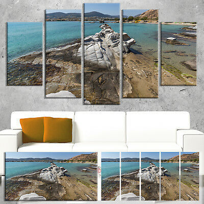 Designart 'Clean Waters and Rock Formations' Landscape Wall Blue