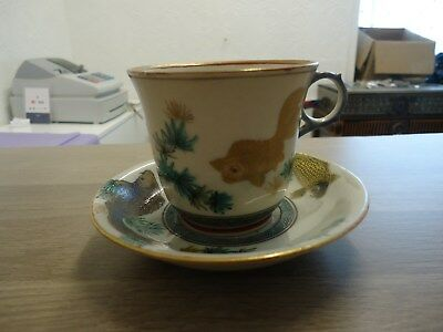 antique chinese cup and saucer decorated with fish