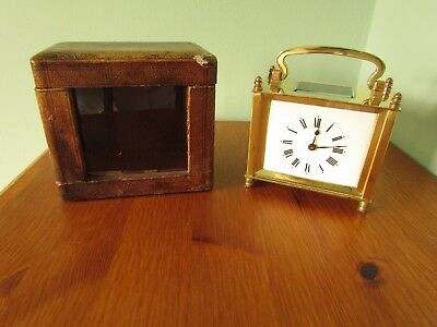 Late 19th century French 8 day carriage clock and carrying case.