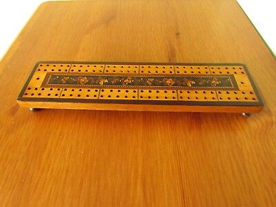 A very fine 19th Century Tunbridge Ware footed crib board with pegs in base