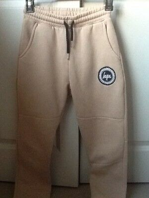 Girls Jogging bottoms by Hype in beige, size 4.