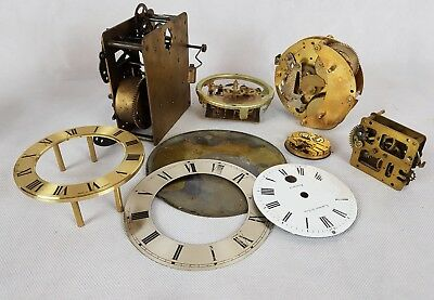Vintage clock movements for parts.