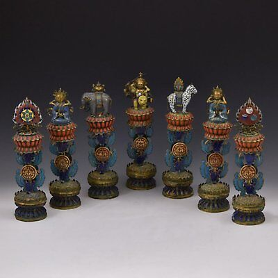 A Rare Set of Seven Chinese Antique Sino-Tibetan Bronze Buddhist Ashtamangalas.