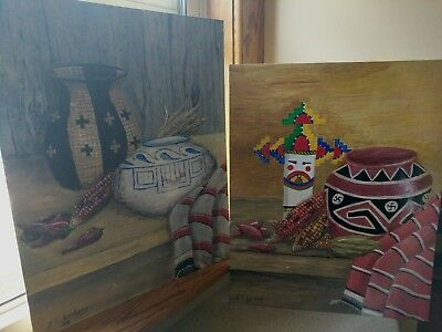Pair of signed original still life paintings of pottery basket kachina blanket