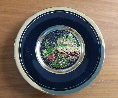 Japanese cloisonne plate in black and gold with peacocks