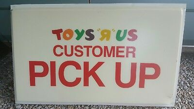 48x30. ORIGINAL TOYS R US CUSTOMER PICK UP BUILDING sign with damage to corner