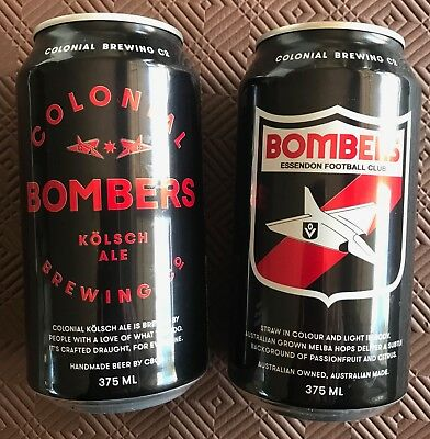 Two AFL Essendon Football Club empty beer cans