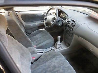 1999 Toyota Corolla  Corolla, black, manual, runs GREAT, very little rust, great winter/student car