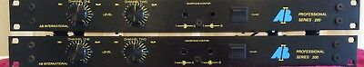 A Pair Of Ab International Professional Series 200 Power Amplifier Rack Mount