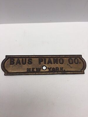 """Early 11"""" x 2.5"""" Piano Brass Emblem Badge JACOB DOLL / BAUS PIANO CO. NEW YORK"""