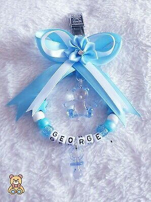 Personalised stunning pram charm in blue and white for baby boys.
