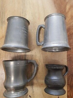 Collecton of 4 pewter mugs ..look at stamp marks