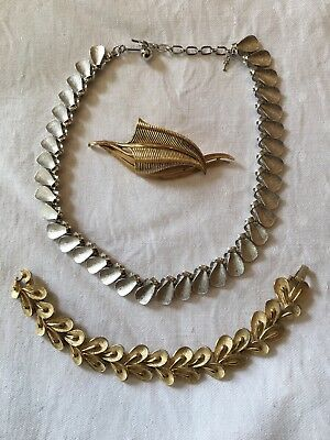 Three pieces of Vintage TRIFARI costume jewellery: Necklace, Bracelet and Brooch
