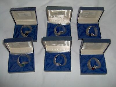 "Vintage napkin rings in white metal and ""gemstones"" set of six in original boxes"