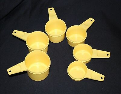 Tupperware measuring cups x6 in vgc yellow gold