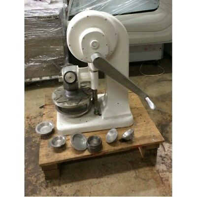 Dial-O-Matic Pie Press Model  D301 comes with several different dies (warranty)