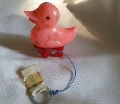 RARE COLLECTIBLE CELLULOID PINK CHICK on WHEELS CANDY CONTAINER