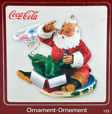 2009 Coca Cola Santa Playing with a Helicopter Christmas Heirloom Ornaments Hard