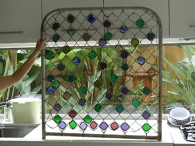 Stained glass in vintage metal gate