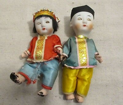2 Stone Bisque Head Chinese Dolls- Boy & Girl- sleep eyes- need restringing