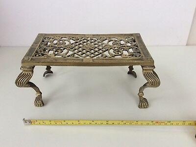 cast iron trivet With Gilt Veneer