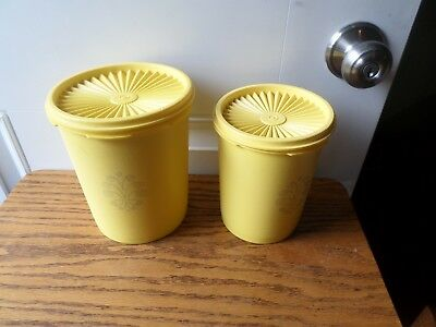 2 pieces of a tupperware canister set  yellow with lids