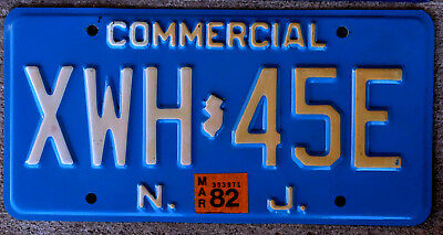 Cream on Light Blue New Jersey COMMERCIAL License Plate with a 1982 Sticker