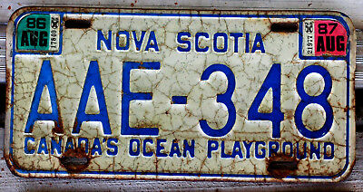 Blue and White Nova Scotia License Plate with 1986 and 1987 Stickers