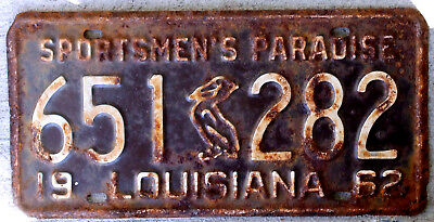 1962 White on Brown Louisiana License Plate with the Embossed Brown Pelican
