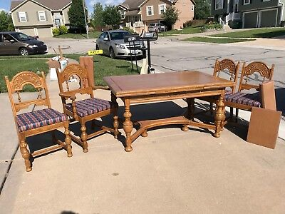 Antique extending oak French dining table with table pads and chairs